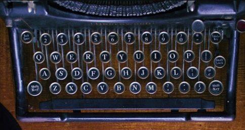 old-fashioned typewriter on wood desk