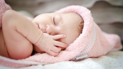 sleeping baby in pink fuzzy